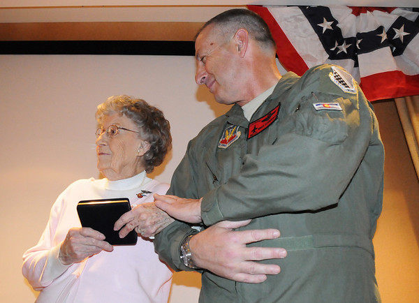 Major General H. Michael Edwards, Colorado National Guard, holds Josephine Kater Robinson, 92, left, a WWII WASP, Women Airforce Service Pilots, arm after Robinson received her Congressional Gold Medal during the ceremony at The Stratford at the Flatirons on Saturday.<br /> May 22, 2010<br /> Staff photo/ David R. Jennings