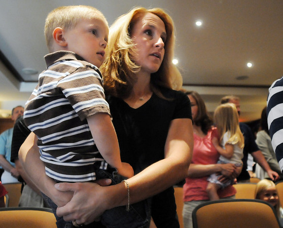Katie Floyd holds her son Joshua, 3, grand daughter and great grandson of  Josephine Kater Robinson, 92, a WWII WASP, Women Airforce Service Pilots, during the Congressional Gold Medal ceremony for Robinson at The Stratford at the Flatirons on Saturday.<br /> May 22, 2010<br /> Staff photo/ David R. Jennings