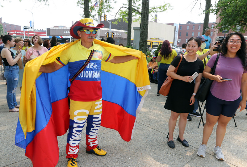 JUly 20, 2021 -- Colombian flag-raising at Lowell City Hall. Ruby Patino of Maynard is draped in the Colombian flag. SUN/Julia Malakie