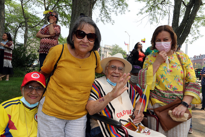 JUly 20, 2021 -- Colombian flag-raising at Lowell City Hall. From left, Celina Pareja, 85, of Lowell, Martha Alvarado of Dracut, with her father Alfonso Valencia, 103, of Dracut, and sister Ninfa Cardona of Lowell (who is sister-in-law of Pareja.)  SUN/Julia Malakie