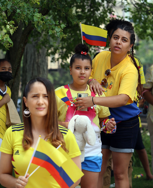JUly 20, 2021 -- Colombian flag-raising at Lowell City Hall. Front to back: Adriana Herrera, Melody Veras, 8, and Melody's mother Jennifer Veras, all of Lowell. SUN/Julia Malakie