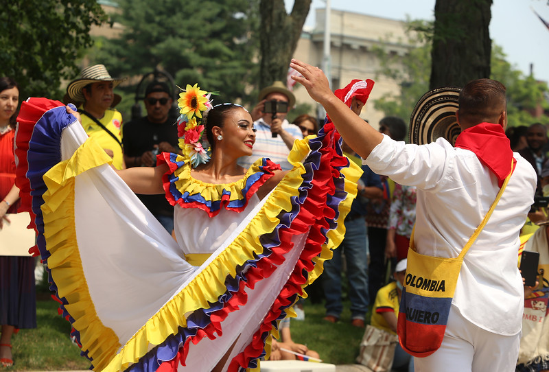 JUly 20, 2021 -- Colombian flag-raising at Lowell City Hall. Carolina Tobon of East Boston and Dior Castaneda of Bellingham dance. SUN/Julia Malakie