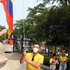 JUly 20, 2021 -- Colombian flag-raising at Lowell City Hall. Dr. Jorge Gonzalez of Groton raises the flag. SUN/Julia Malakie
