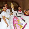 JUly 20, 2021 -- Colombian flag-raising at Lowell City Hall. Dance group Bajucol: Luis Ortega of Everett and Samantha Correa of Winthrop, left, and Alexis Taborda of East Boston and Sofia Blandino of Everett, right, wait to perform again after a change of dress. SUN/Julia Malakie