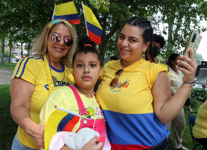 JUly 20, 2021 -- Colombian flag-raising at Lowell City Hall. Melody Veras, 8, her mother Jennifer Veras, right, and Jennifer's mother Virginia Griselas, all of Lowell. SUN/Julia Malakie