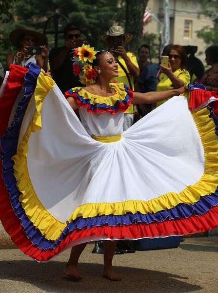 JUly 20, 2021 -- Colombian flag-raising at Lowell City Hall. Carolina Tobon of East Boston dances. SUN/Julia Malakie