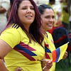 JUly 20, 2021 -- Carolina Rios, left, and Carolina Pino, both of Lowell, and owners of a new food truck, Mira Ve, watch Colombian flag-raising ceremony at Lowell City Hall. SUN/Julia Malakie
