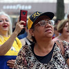 JUly 20, 2021 -- Colombian flag-raising at Lowell City Hall. Maria Claudio, right, and Luz Toro, left, both of Lowell, record the event. SUN/Julia Malakie