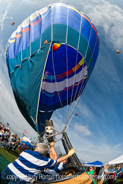 A crew is hot inflating a hot air balloon at the Colorado Balloon Classic in Colorado Springs.