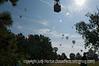 A man watches as balloon in the Colorado Balloon Classic come into the landing area.