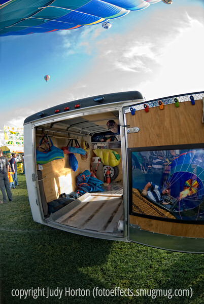 A view of a portion of the Colorado Balloon Classic festival from the perspective of a reflection in the trailer door.  The detail in this one needs to be viewed in the larger sizes.