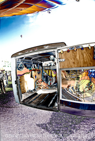 A view of a portion of the Colorado Balloon Classic festival from the perspective of a reflection in the trailer door.