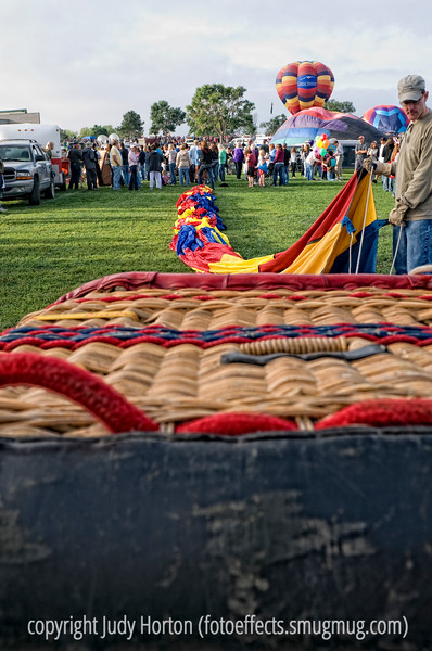 The hot air balloon is laid out on the ground prior to beginning the inflation process.