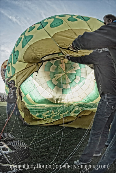 A hot air balloon is being cold inflated at the Colorado Balloon Classic festival in Colorado Springs.