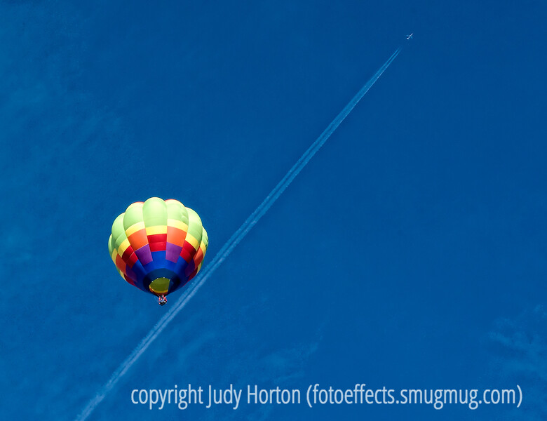 A commercial jet appears to fly quite close to a hot air balloon at the Colorado Balloon Classic.  In reality, they are quite far apart.