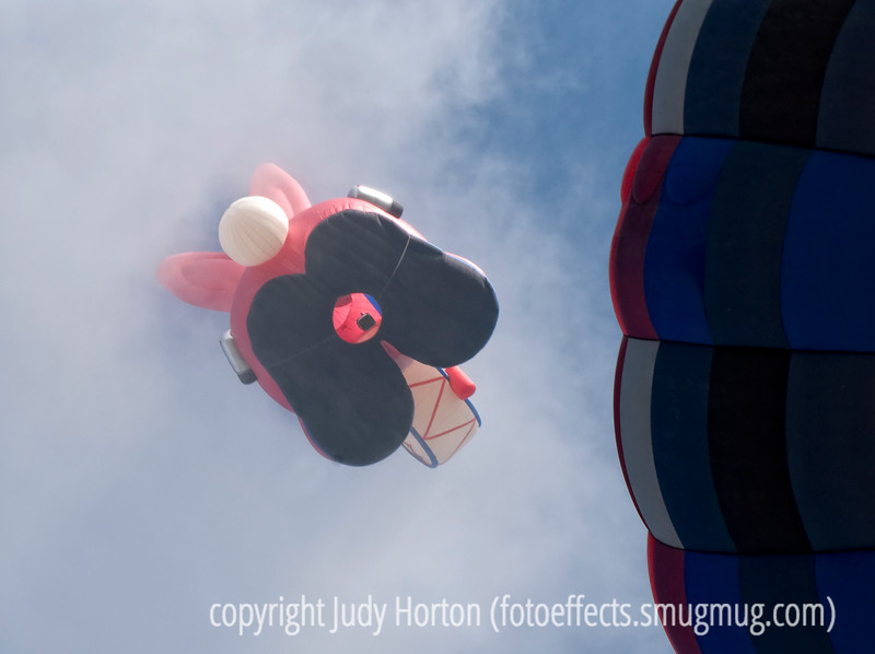 Energizer bunny hot air ballon is partially obscured by foggy clouds