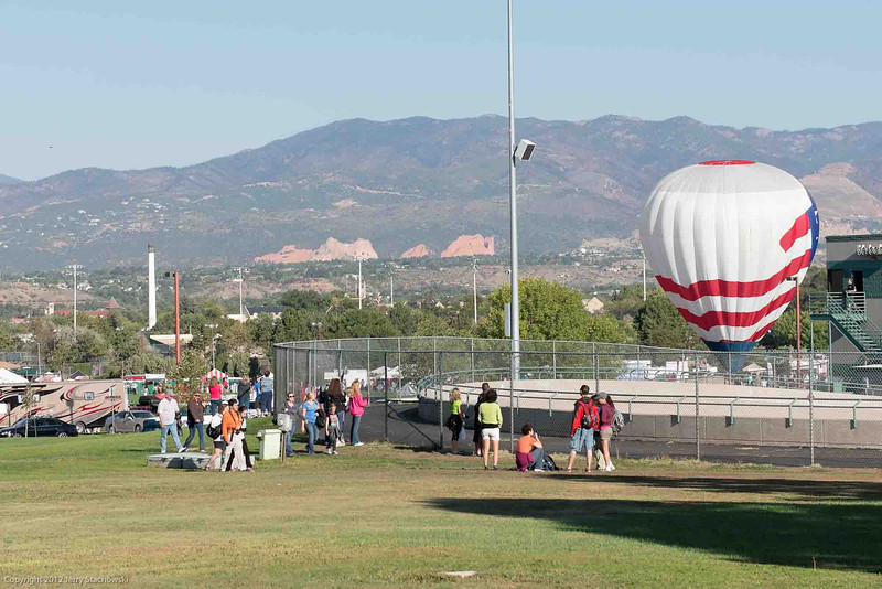 Colorado Springs Balloon Classic 2012.  This shot shows the balloon that didn't fly but was there to answer questions, with Garden of the Gods and Pikes Peak in the background.