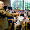 John P. Cleary | The Herald Bulletin<br /> Auctioneer Richard Symmes points to a bidder during a live auction of donated items to benefit Special Olympics at the Colts Breakfast 2014 with head coach Chuck Pagano.<br /> <br /> <br /> <br /> <br /> olts Breakfast 2014 with head coach Chuck Pagano.