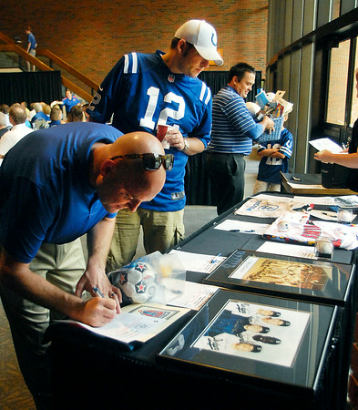John P. Cleary | The Herald Bulletin<br /> People looking over, and bidding on, some of the silent auction items during the Colts Breakfast 2014 with head coach Chuck Pagano.