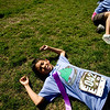 Jorge Jimenez, 10, lays down after finishing the annual Mile Marathon at Columbine Elementary School in Boulder, Friday, May 21, 2010. Elite athletes, teachers, students, and parents joined in the race that follows one mile of the Bolder Boulder course. <br /> <br /> Kasia Broussalian
