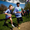 Fith grader Pano Garry, 12, and race founder Rich Castro finish first and second during the annual Mile Marathon at Columbine Elementary School in Boulder, Friday, May 21, 2010. Elite athletes, teachers, students, and parents joined in the race that follows one mile of the Bolder Boulder course. <br /> <br /> Kasia Broussalian