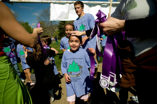 Lizeth Curiel, 5, gets a pat on the head after finishing the annual Mile Marathon at Columbine Elementary School in Boulder, Friday, May 21, 2010. Elite athletes, teachers, students, and parents joined in the race that follows one mile of the Bolder Boulder course. <br /> <br /> Kasia Broussalian