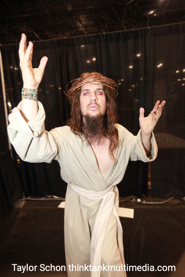 """JESUS / MICHAEL BODNAR<br /> <br /> What made you choose to be the superhero son of god? <br /> <br /> """"It found me."""" <br /> <br /> Uh huh. When was the last time you sinned?<br /> <br /> """"I am the Messiah. Its about getting to a different level of consciousness"""". <br /> <br /> Did jesus have those eyes? <br /> <br /> """"I had these for another costume, it seemed to add a little more.""""<br /> <br /> Superpower?<br /> <br /> """"The capacity to forgive any regression.""""<br /> <br /> Sounds progressive. How's it working with the girls?<br /> <br /> """"Its better than you could possibly imagine!""""<br /> <br /> They seek redemption?  Sins forgiven?<br /> <br /> """"They want more than that. [laughs].<br /> <br /> Result: Sure fire winner. Who wouldn't want to date the son of a God? The capacity to turn water into wine, to walk on water, to forgive you over and over? The ladies love it. Epic Success. 10/10!"""
