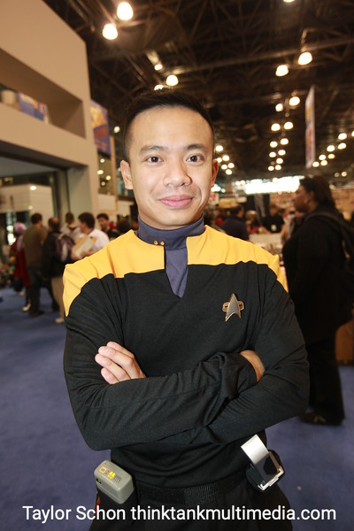 """Mike / Trekkie<br /> <br /> """"Ive been a Trekkie most of my life - but I'm wearing this to promote our Star Trek fan film - startreksutherland.com.""""<br /> <br /> How does it work with the ladies? <br /> <br /> """"Well it works much more when you're a lady in uniform….""""<br /> <br /> If you could have any superpower what would it be?<br /> <br /> """"For comicCon, being able to stand for long period of time without getting tired.""""<br /> <br /> Pah! Of all powers. Ok then, who's better? Kirk or Picard?<br /> <br /> I'd have to say Captain Kirk crossed the line a lot, mixing it up with two many ladies on the ship, and I think Picard kept a more professional distance with people.""""<br /> <br /> Spoken like a true nerd. <br /> <br /> """"Yeah but I secretly would like to be Kirk.""""<br /> <br /> Aha!<br /> <br /> Result: While women can wear anything for attraction, the Male Trekkie outfit does not set women to stun. 3/10"""