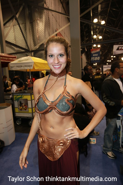 """Andrea Feczko / PRINCESS LEIA<br /> <br /> """"This is my second time… but the first time i've dressed up, so its a whole new playing field.""""<br /> <br /> Were you just taking a cheap shot at our inner geek by being the number one fantasy role of Princess Leia?<br /> <br /> """"I actually wanted to be Princess Peach, but I decided to go big or go home. Kids dressed up as Princesses have come up to me, which I found interesting, because I'm a half naked princess… they have something to aspire to. Some people have tried to cop a feel!""""<br /> <br /> Would you ever wear this costume in the bedroom?<br /> <br /> """"Oh absolutely. I've worn better!""""<br /> <br /> Result: Tried and Tested, the Princess Leia get up is always Guaranteed success for uber geek man internal pant explosions."""