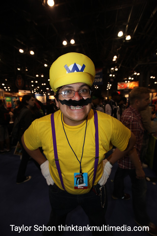 """WARIO / RICHARD Benitez<br /> <br /> Why Wario?<br /> <br /> """"Well people told me all last year I look like Wario. I didn't do it from Haloween, so I'd do it for queens."""" <br /> <br /> Any girls ask to see your plumbing?<br /> <br /> [Unconvincingly] """"A few.""""<br /> <br /> Did you want to see their piping? <br /> <br /> [Unconvincingly] """"I already did.""""<br /> <br /> What has the best thing you've done today?<br /> <br /> """"I went up on stage and did the Michael Jackson experience"""" (New Video Game to be released by Nintendo end of the year). <br /> <br /> How does it feel to be Michael Jackson ? Did you want to do anything like hold a baby out a window or other, erm, childlike activity? <br /> <br /> """"It was really awesome. I wanted to get a fake nose, I wanted to go black and white.<br /> <br /> You're bad.<br /> <br /> Result: A shock and surprise, but neither Michael Jackson or Wario will work too woo the women. Yellow is also fattening. 3/10"""