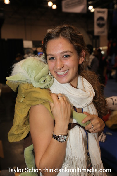 """Liz Gordon / Yoda Pervert<br /> <br /> """"Do you know you have Yoda humping your back?""""<br /> <br /> """"I love him, he makes me feel great! I'm rocking' Yoda on my back! Yeah!""""<br /> <br /> Would the ladies like it if a guy had one?<br /> <br /> """"Depends if she's into it. I'd probably laugh and then say 'Good for him'""""!<br /> <br /> Would it work chemistry magic on you?<br /> <br /> """"Depends what the guy's like!""""<br /> <br /> Result: Mmmm! Furry Green thing will you show her! An exceptional opener, but then you must back it up with something to keep the conversation going... 7.5/10"""