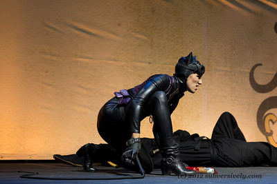 Catwoman (Robin Sol) waits by a downed ninja.