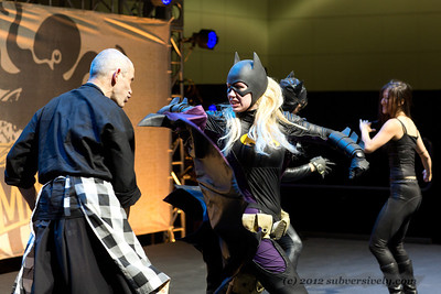 Batgirl (Marisha Ray) demonstrates a move on fight choreographer Paradox Pollack.
