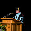 Dr. James Wright, Chadron State College professor of business, speaks during CSC's graduate commencement ceremony. Wright, who has worked at CSC since 1983, delivered the commencement address. (Photo by Daniel Binkard/Chadron State College)