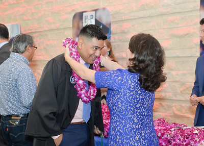 Joseph Tenerias receives his lei before the Spring 2018 Commencement ceremony held on May 12, 2018.