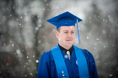 Winter Commencement 2014 graduate in heavy snow outside of the College of Technology