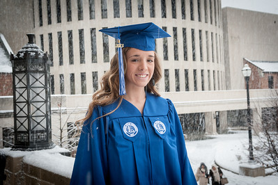 Graduates in heavy snow storm on day of 2014 winter commencement