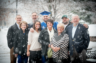 Family poses with graduate in heavy snowstorm on commencement day winter 2014