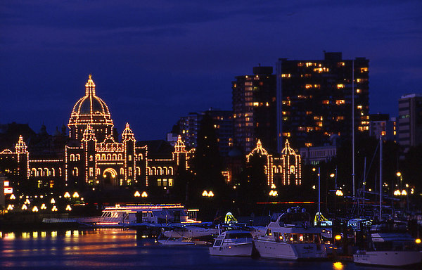 Tourism and Travel Photography - Victoria, B.C. Legislature and inner harbour at night.