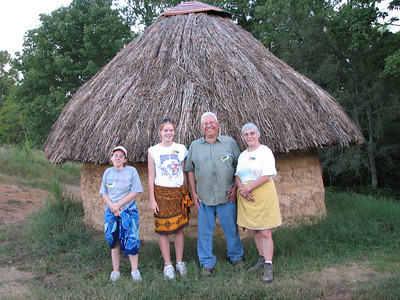 The Vasco family in front of their Mozambique hut