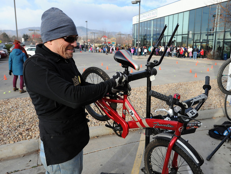 "Mark McIntyre  tunes up one of the bikes that will be given away.<br /> Community Cycles hosted their 7th annual Kids' Holiday Bike Giveaway on Sunday.<br /> For more photos and a video of the bike giveaway, go to  <a href=""http://www.dailycamera.com"">http://www.dailycamera.com</a>.<br /> Cliff Grassmick  / December 16, 2012"