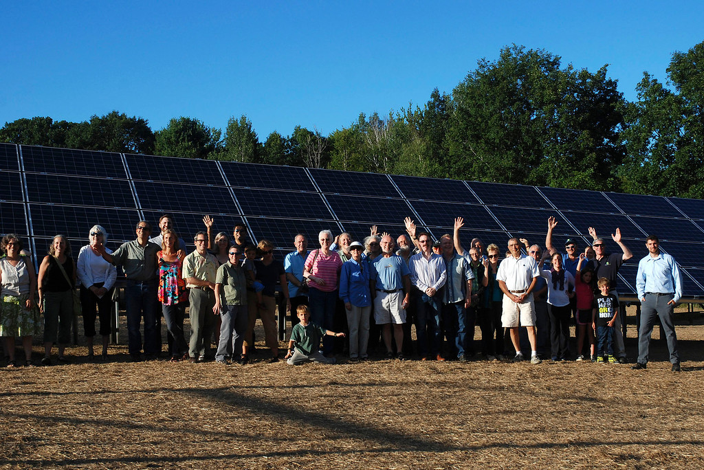 . Kayla Rice/Reformer                                 (Far right) Nick Ziter and community members stand in front of a solar panel during the grand opening of the newly built community solar array in Putney.
