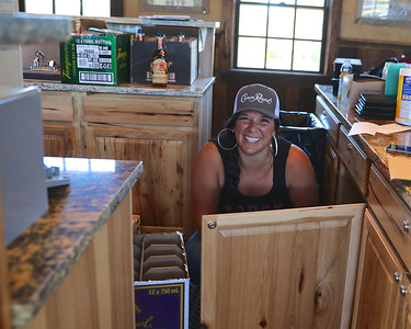 Jenna Jacobson stocking The Plaza with beverages