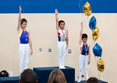 Three excited and proud male gymnasts.