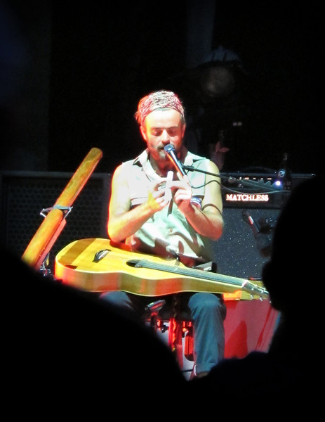 The opening act was Xavier Rudd and his group Izintaba. Rudd is an Australian singer, songwriter, and instrumentalist. On his right is a didgeridoo, a wind instrument from the indigenous Australians of northern Australia.