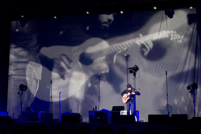 Rodrigo performs a solo with his image projected on the background.