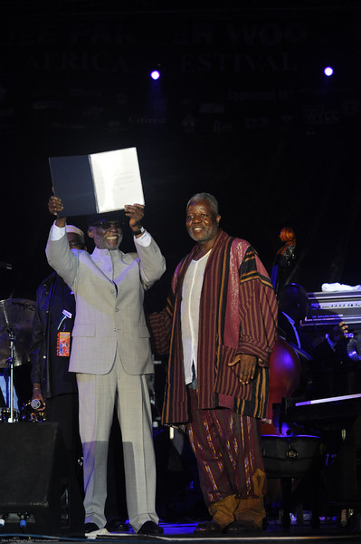 Ahmad Jamal receiving a certificate from the Mayor's Office