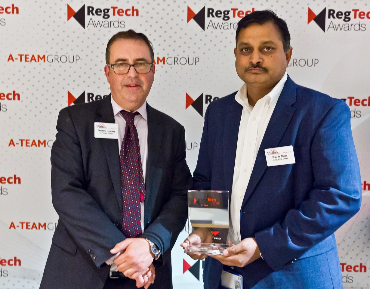 Andrew Delaney, A-Team Group presents a RegTech Award to Reddy Kota, Deutsche Bank at the RedTech Summit NYC 16 Nov 2017