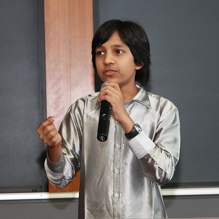 """Master Kishan of Bangalore, India, speaking at the India Development Service 2009 Symposium at Loyola University Medical School, Maywood,(Chicago) IL at age 14 in 2009 about his film, """"Care of Footpath'"""" Master Kishan is listed in the Guinness Book of Wolrd Records as the Youngest Movie Producer on earth."""