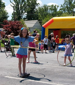 Hula hoops near the moon bounce -- Beth El End-of-Year Family Picnic 2012